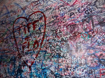 Lovers write their names on Juliet's wall