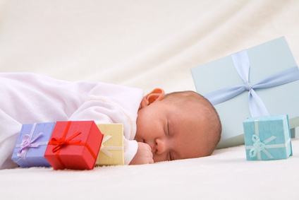 Baby Sleeping By Gift Boxes