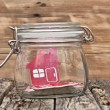 shape home sign in a glass jar on wooden table