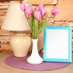 Colorful photo frame, lamp and flowers