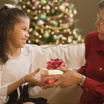 Grandmother and grand daughter exchanging gifts