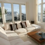 Interior of modern living room with beige corner suite