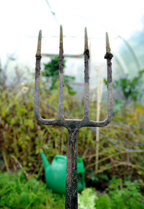 fork and watering can