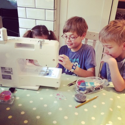 Eddie teaching Paddy and Libby how to sew