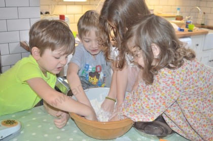 Joseph, Paddy, Libby and Anna get stuck in to get the pasta dough made...
