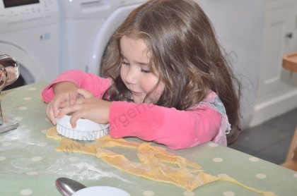 Isobel uses a biscuit cutter to cut out circles for the ravioli