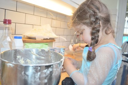Here she is being very helpful indeed (picking the dough off her fingers)