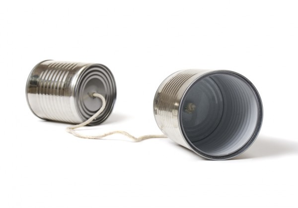 Tin can phone isolated on white background