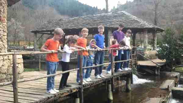 albania farma sotira children on bridge