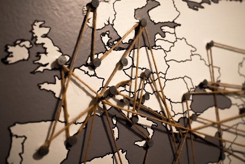 map with pins and string